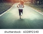 women jogging on the nature... | Shutterstock . vector #632892140