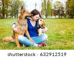 Girl With Dogs In The Park