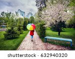 woman in red coat with rainbow... | Shutterstock . vector #632940320