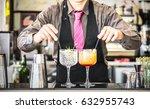 classic bartender serving gin...   Shutterstock . vector #632955743