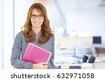 shot of a smiling woman holding ... | Shutterstock . vector #632971058
