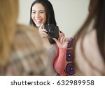 woman taking photograph of... | Shutterstock . vector #632989958
