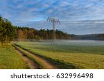 Power Pole At A Meadow Covered...