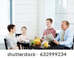 cheerful modern family of four... | Shutterstock . vector #632999234
