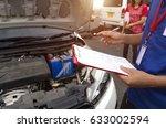 insurance agent examining car... | Shutterstock . vector #633002594
