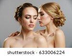 two pretty girls posing naked...   Shutterstock . vector #633006224
