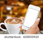 woman using smantphone in cafe. | Shutterstock . vector #633033410