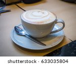 hot capuccino coffee cup | Shutterstock . vector #633035804