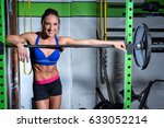 woman leaning on weights with a ... | Shutterstock . vector #633052214