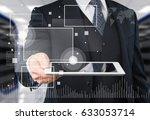 man holding digital tablet. | Shutterstock . vector #633053714