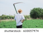 worker with a scythe in the... | Shutterstock . vector #633057974