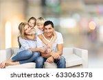 family on sofa. | Shutterstock . vector #633063578