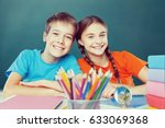 happy children sitting by the... | Shutterstock . vector #633069368