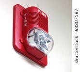 A fire alarm with built in strobe light to alert in case of fire. - stock photo