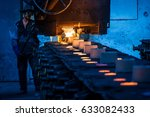 Foundry Worker Pouring Hot...