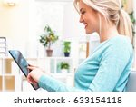 young woman using her tablet... | Shutterstock . vector #633154118