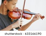 young man play violin in white... | Shutterstock . vector #633166190