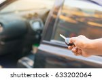 car key and open car | Shutterstock . vector #633202064