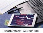 stock market data on tablet pc | Shutterstock . vector #633204788
