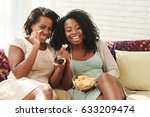 female friends eating potato... | Shutterstock . vector #633209474