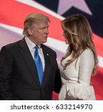 Small photo of Cleveland, Ohio, USA, July 18Th, 2016 Presidential candidate Donald Trump and his Melania at the podium during the Republican National Convention in the Quicken Arena.