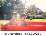 child splashing in the bath... | Shutterstock . vector #633219290