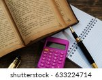 the book and calculator on... | Shutterstock . vector #633224714