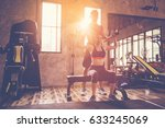 sporty girl doing weight... | Shutterstock . vector #633245069