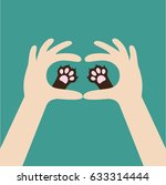 two hands holding cute cat dog... | Shutterstock . vector #633314444