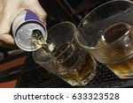 energy drink being poured at a... | Shutterstock . vector #633323528