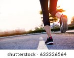 woman running on the road ... | Shutterstock . vector #633326564