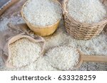 white uncooked rice on wooden... | Shutterstock . vector #633328259