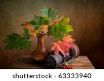 Still Life Autumn concept image with maple leafs and berries - stock photo