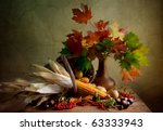Still Life Autumn concept image with vegetables and wicker basket - stock photo