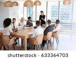 businesswoman stands to address ... | Shutterstock . vector #633364703
