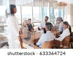 Small photo of Group Of Medical Staff Meeting Around Table In Hospital