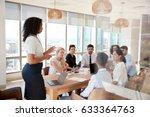 businesswoman leads meeting... | Shutterstock . vector #633364763