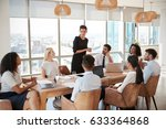 businesswoman leads meeting... | Shutterstock . vector #633364868
