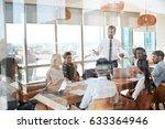 businessman leads meeting... | Shutterstock . vector #633364946