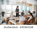 businesswoman leads meeting... | Shutterstock . vector #633365168