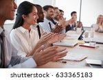 businesspeople around boardroom ... | Shutterstock . vector #633365183