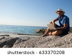 smiling man sitting on the... | Shutterstock . vector #633370208