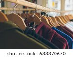 clothes hanging on a rails in a ... | Shutterstock . vector #633370670