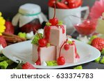cherry panna cotta in macro | Shutterstock . vector #633374783