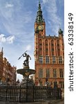Fountain of the Neptune and city hall in Gdansk - Poland - stock photo