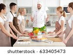 male chef and group of people... | Shutterstock . vector #633405473