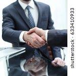 business people shaking hands... | Shutterstock . vector #633410933