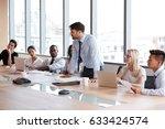 businessman stands to address... | Shutterstock . vector #633424574