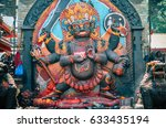 Small photo of Kathmandu, Nepal - 6 May 2016: This huge stone image of Bhairav represents deity Shiva, it was used by the government as a place for people to swear the truth.