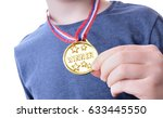 young boy holding up his winner ... | Shutterstock . vector #633445550
